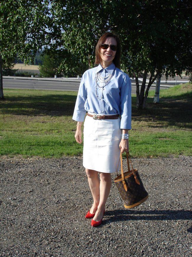 stilist in white knee-length skirt chambray shirt red pumps LV bucket bag sunglasses