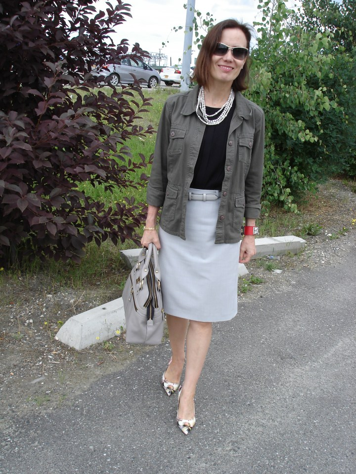 fashion blogger over 50 in skirt with utility jacket for Casual Friday