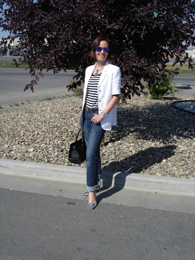 influencer in consigned silver pumps and bag