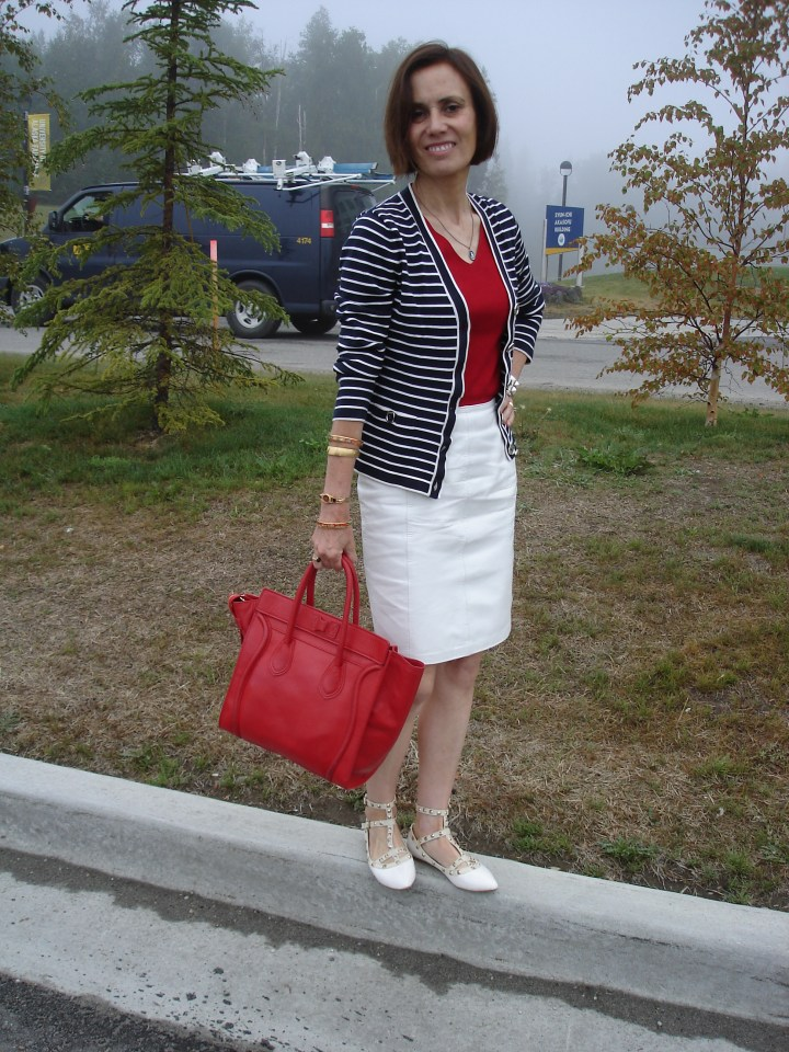 midlife fashion blogger in white skirt, red sweater and blue cardigan
