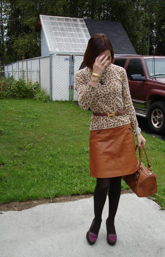 over 50 years old fashion blogger wearing a leopard sweater and leather skirt