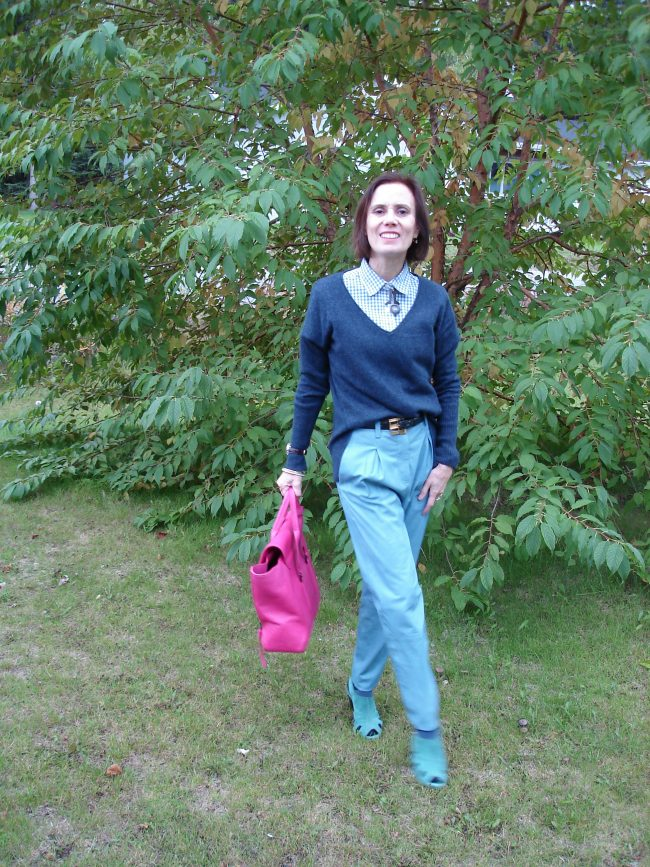 Alaskan blogger in layered shirt, sweater, pants look in blue