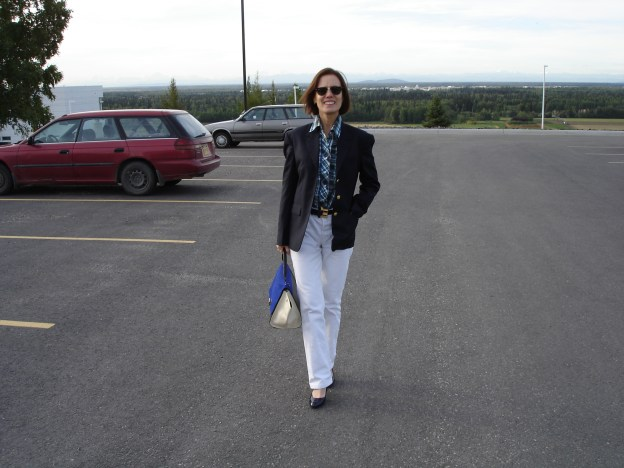 fashion blogger in white-blue business casual look of jeans with navy blazer