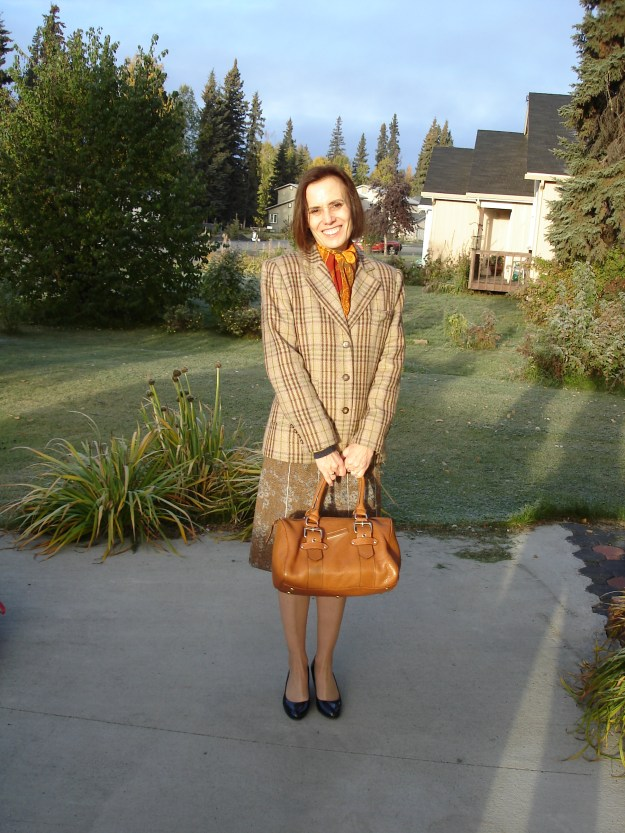 #maturestyle woman in floral tweed skirt with Burberry plaid blazer