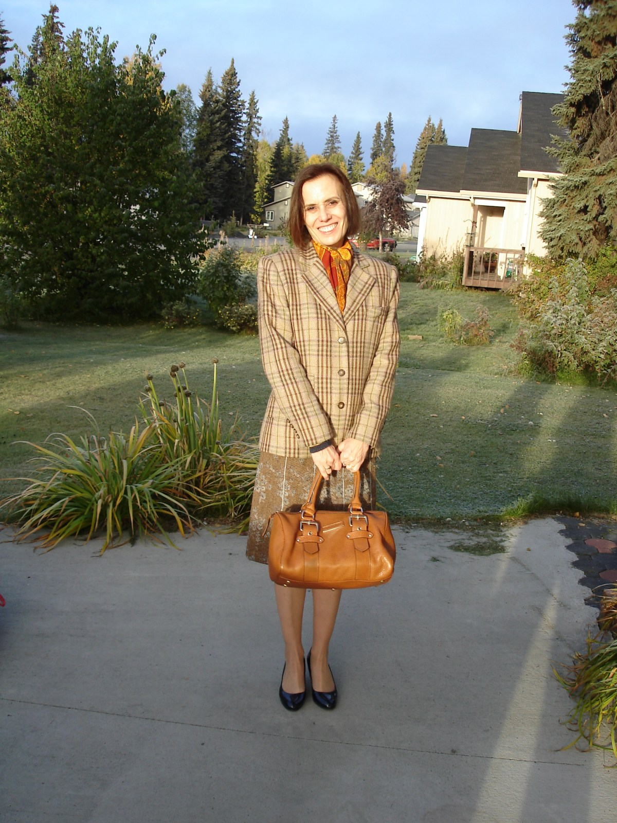 style blogger wearing a tweed skirt styled with outerwear