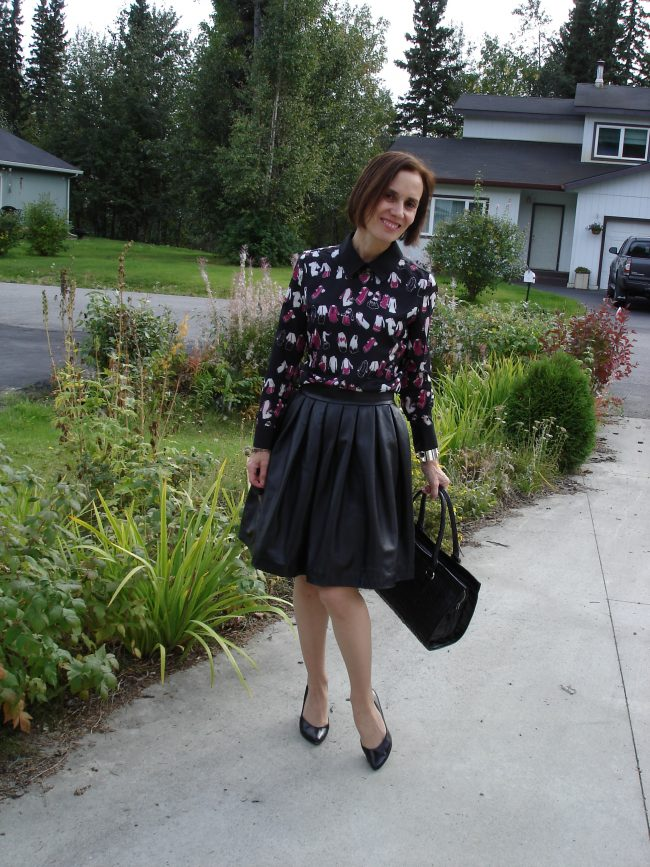 style book author in leather skirt over dress