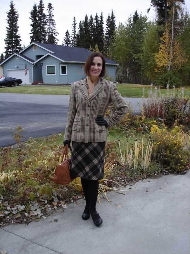 midlife woman wearing a work outfit with two types of plaid