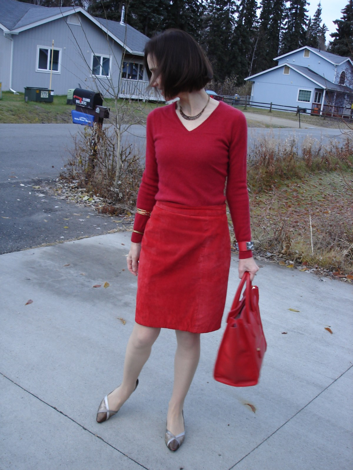 fashion bloger in an all red monochromatic outfit