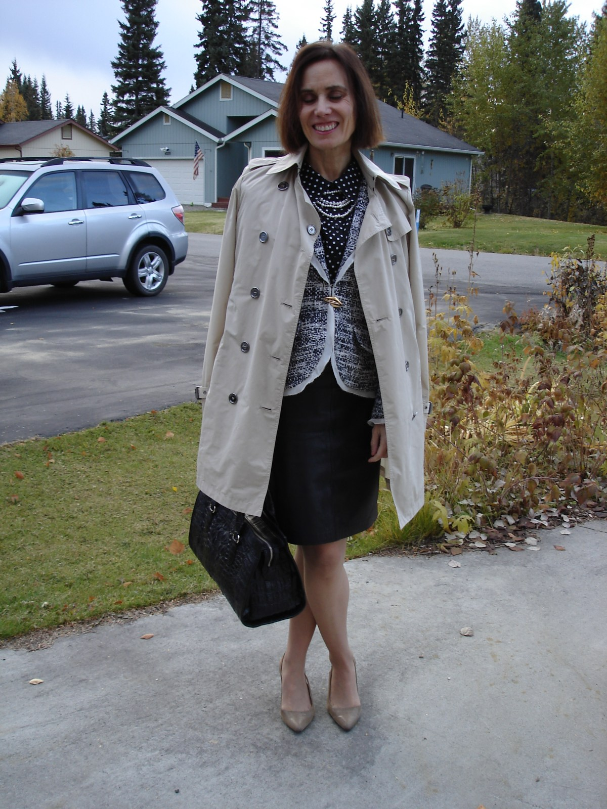 style book author in leather skirt, tweed jacket, trench coat