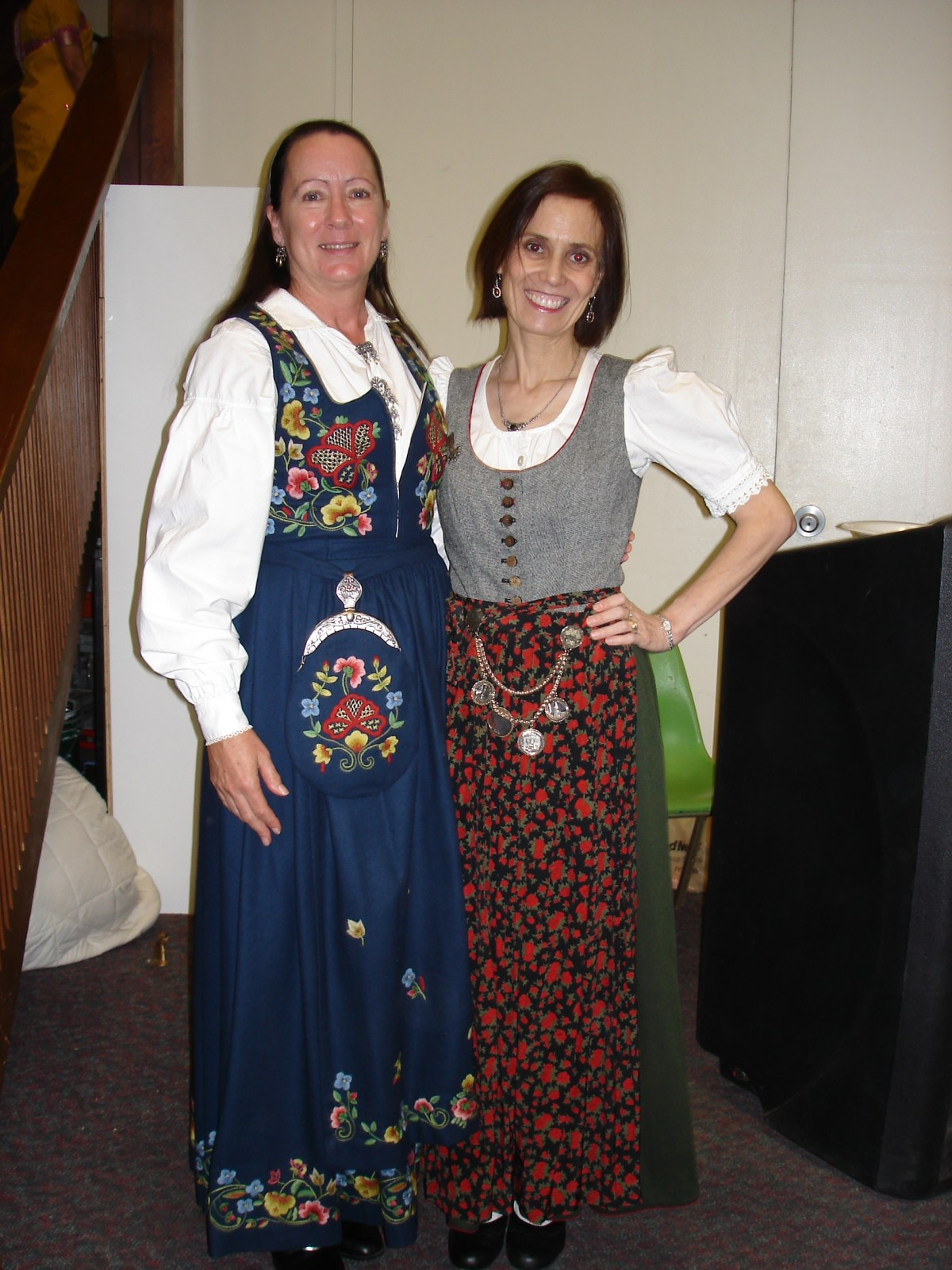 women in dirndls of different heritage dressed up in traditional clothing for a dinning event