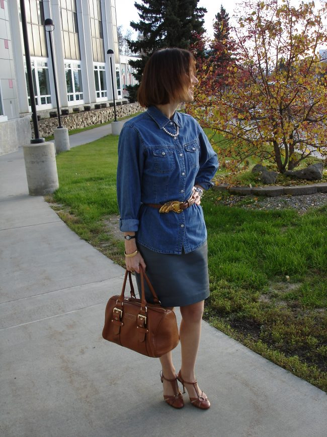 leather sheath as skirt with denim shirt worn over it