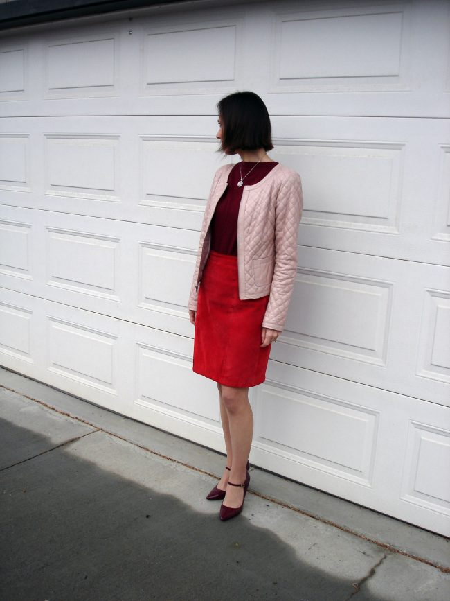 style book author in red skirt, blush jacket