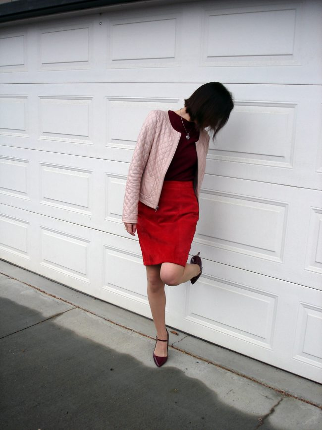 over 50 years old woman in suede skirt blush leather jacket