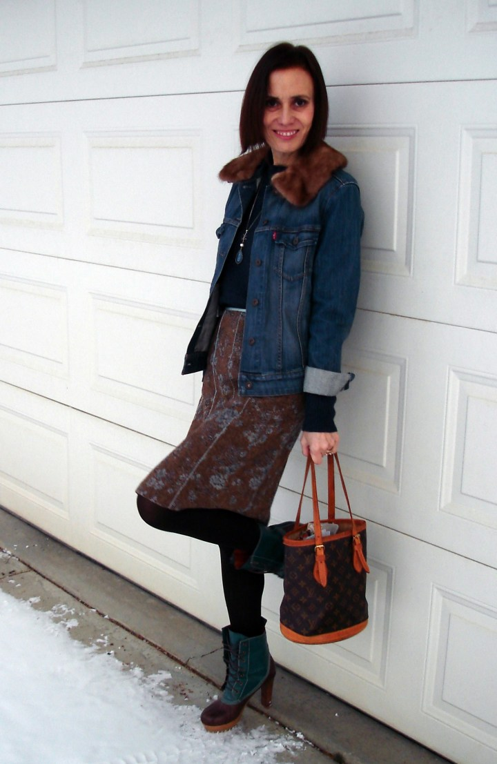 over 50 years old woman wearing a tweed skirt with denim jacket
