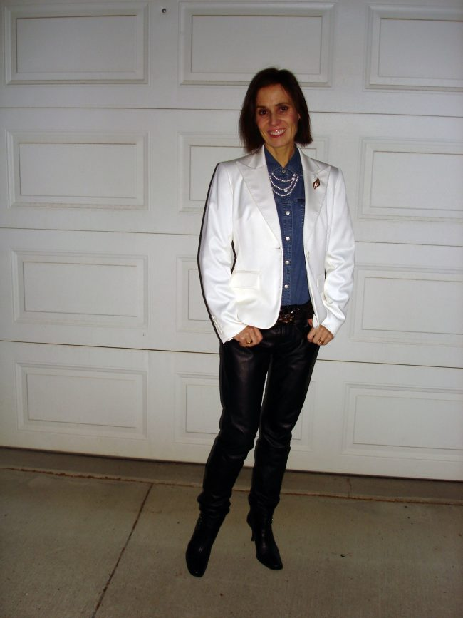 style blogger showing how to wear a white blazer in winter with leather pants