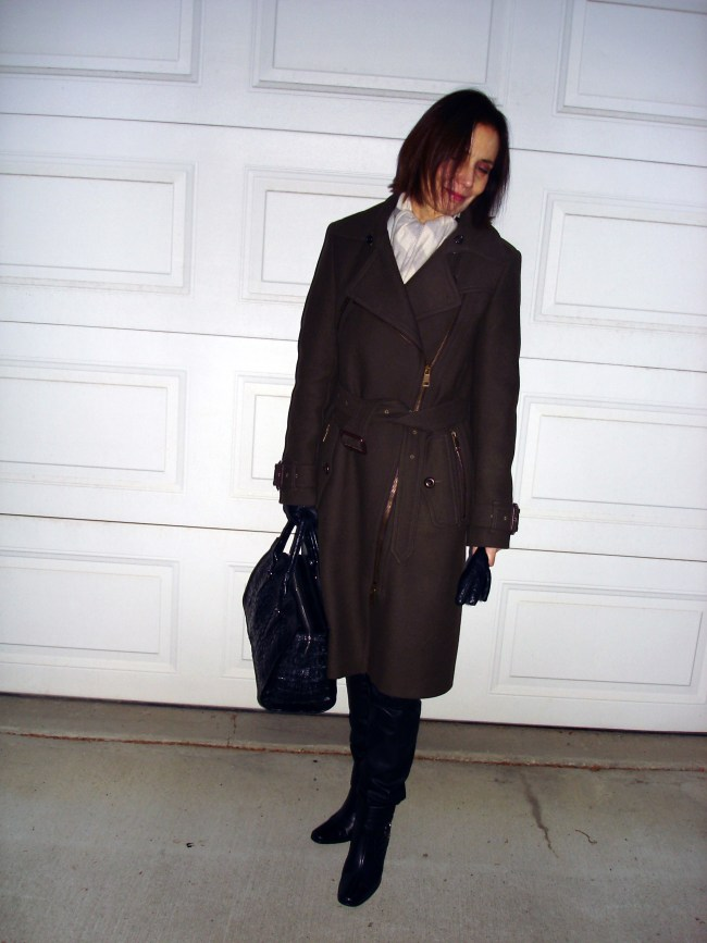 mature blogger in winter street wear with Burberry coat, booties and gloves