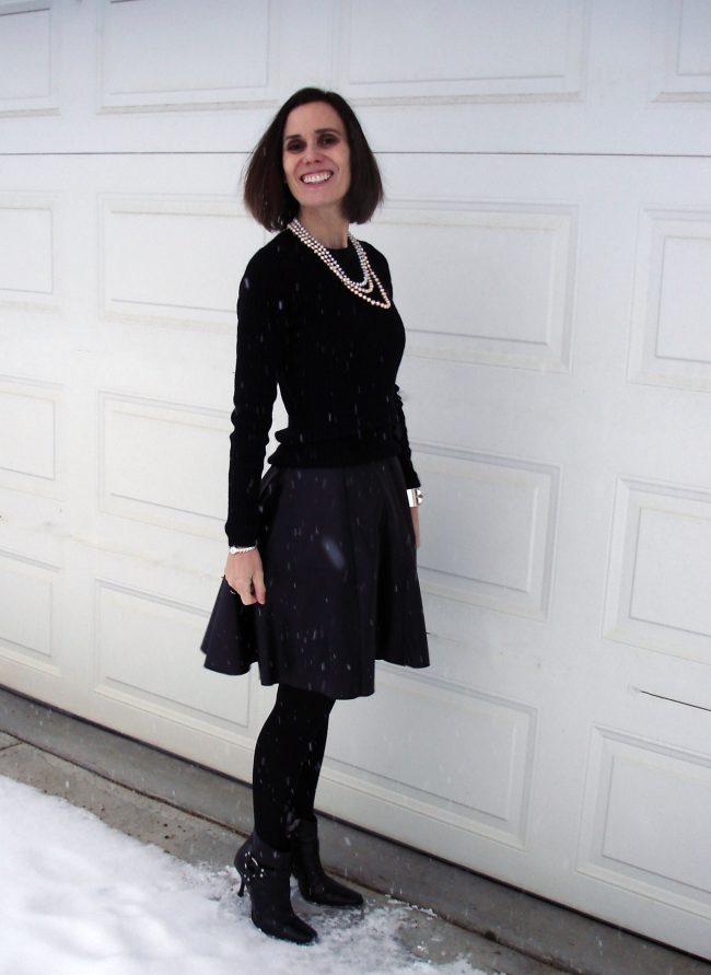 over 50 years old woman in black leather dress and black sweater