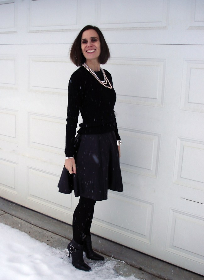 fashion blogger in skater leather skirt