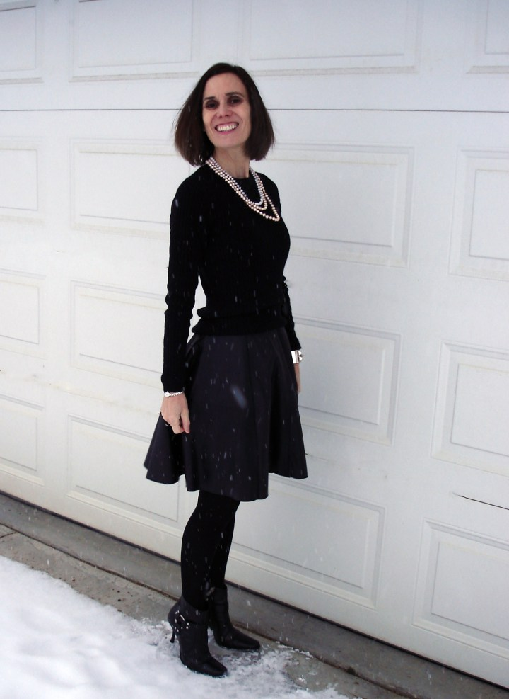 #fashionover50 woman in black leather dress and black sweater