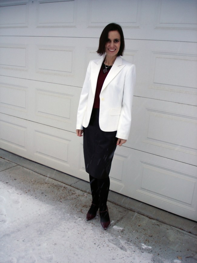 Mature modern office outfit with white blazer and black leather skirt