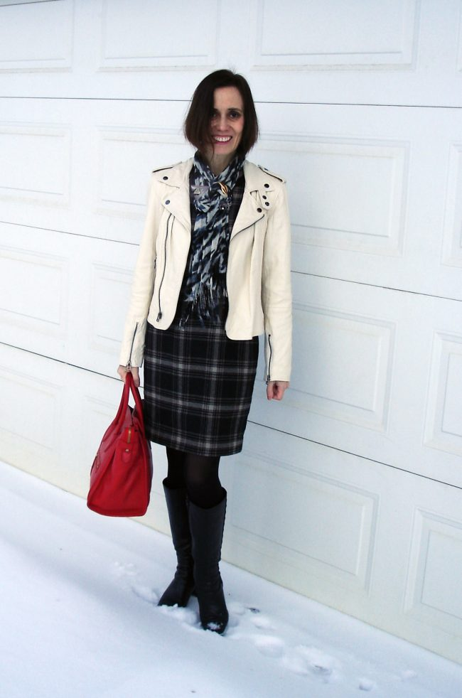 street style blogger in black and white plaid, leopard and leather with tall boots outfit