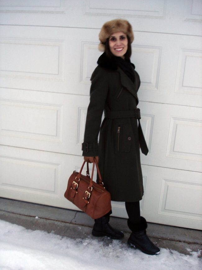stylist in loden coat with head band