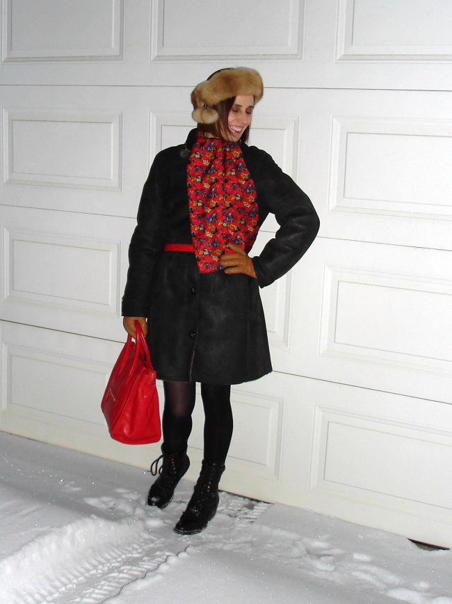 fashion blogger in styled winter outerwear