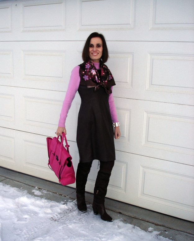 #fashionover50 mature woman in over-the-knee boots, sheath sweater and scarf that ties the colors of the look together