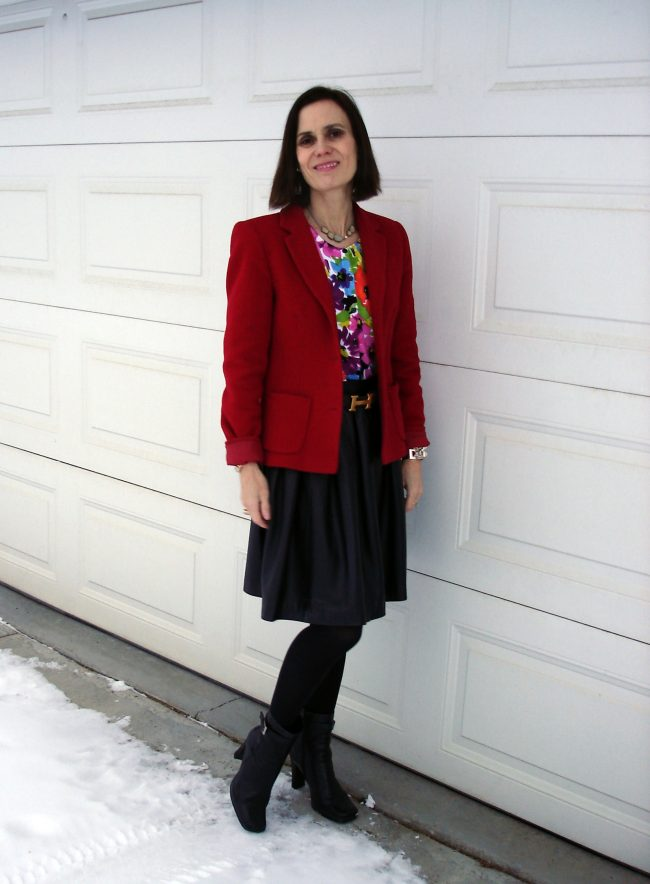 First Friday outfit ideas with red blazer, full leather skirt, colorful cardigan, heavy tights, booties