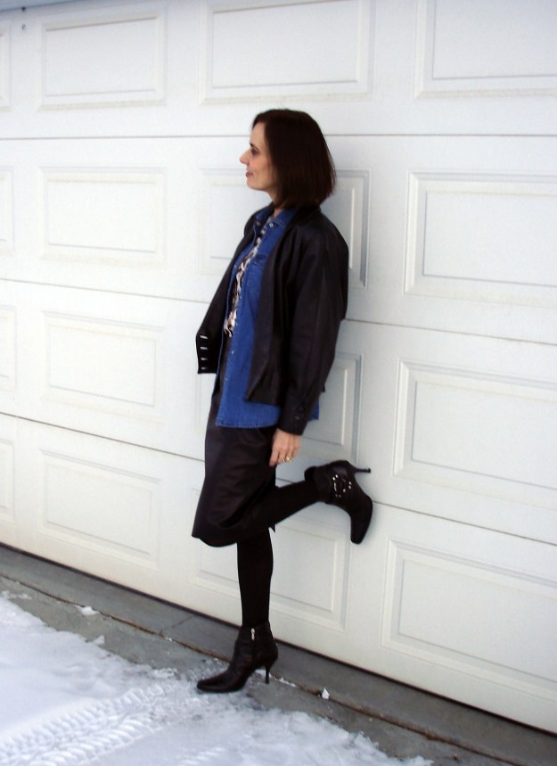 mature style blogger featuring a leather suit like look