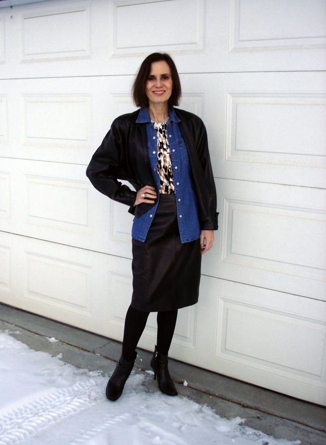 influencer in leather suit with denim shirt