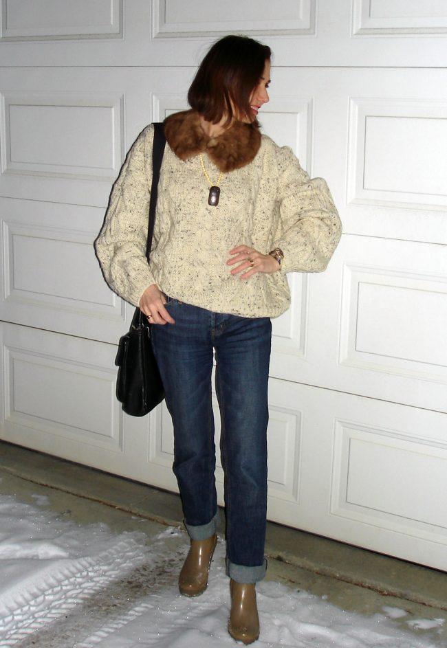 over 50 years old blogger in oversize cable kint sweater, boyfriend jeans running errands outfit