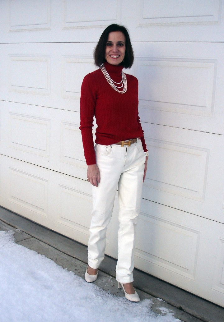 middle aged woman in white leather pants and red sweater