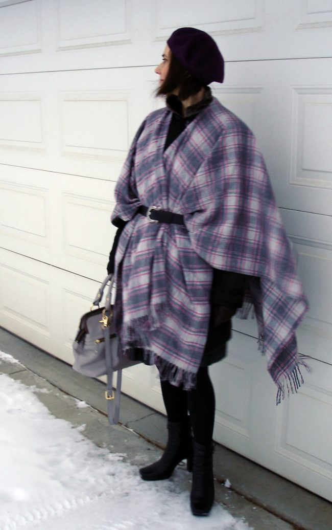 #advancedStyle woman in styled outerwear with plaid blanked scarf, coat, booties and beret