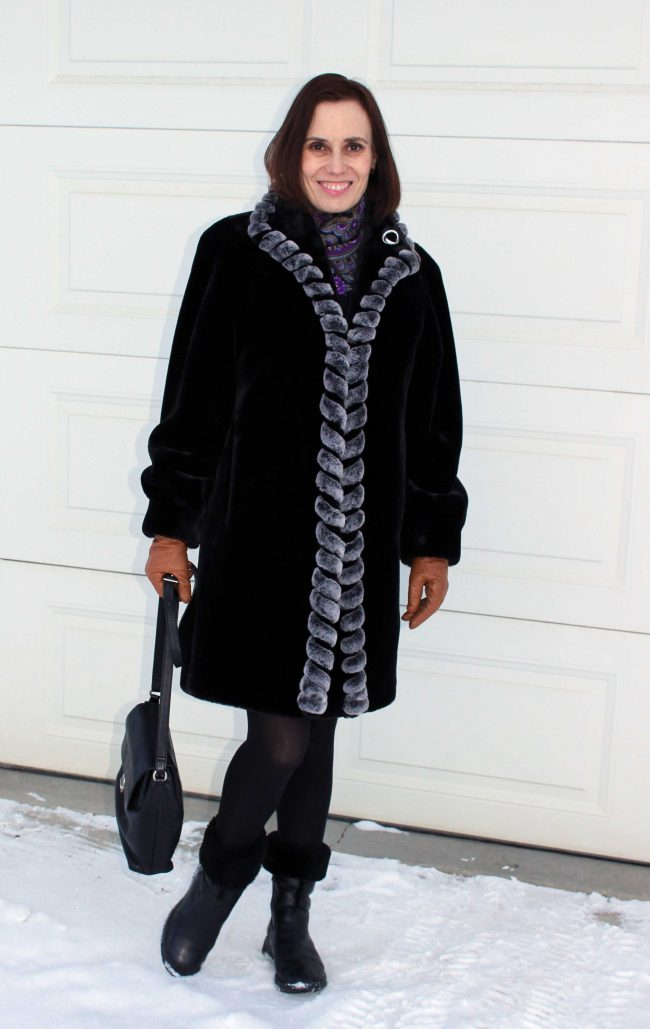 Mature fashion blogger in faux fur frock, boots, gloves and scarf