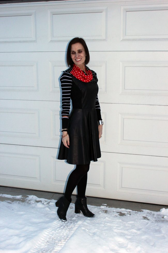 style influencer in leather dress and striped sweater