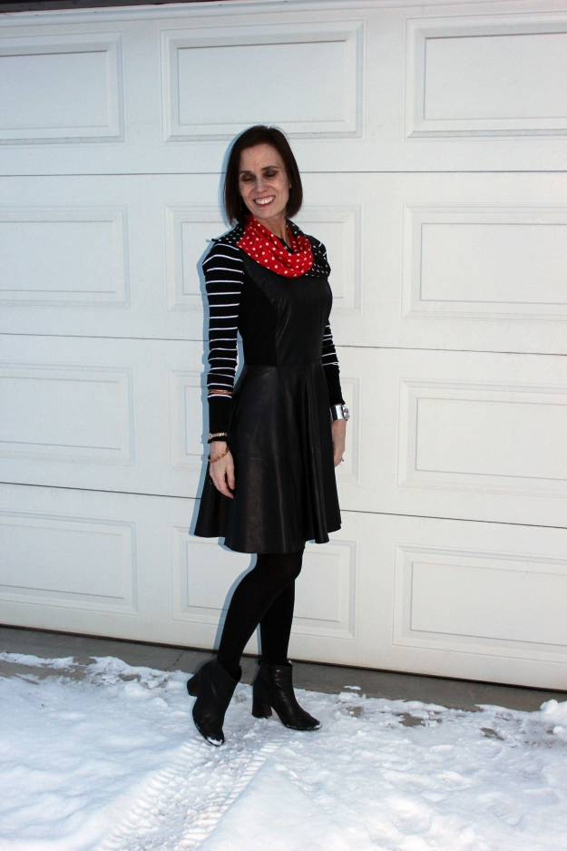 #styleover50 woman in leather dress and striped sweater