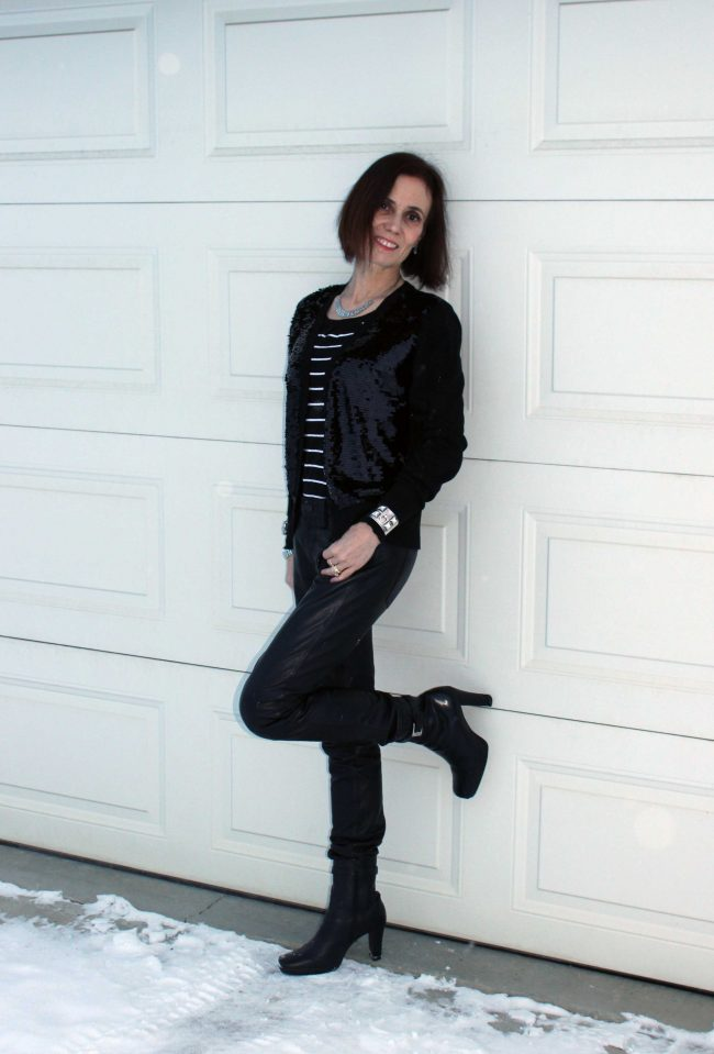 style blogger in edgy casual look with leather pants, sequin cardigan and striped sweater