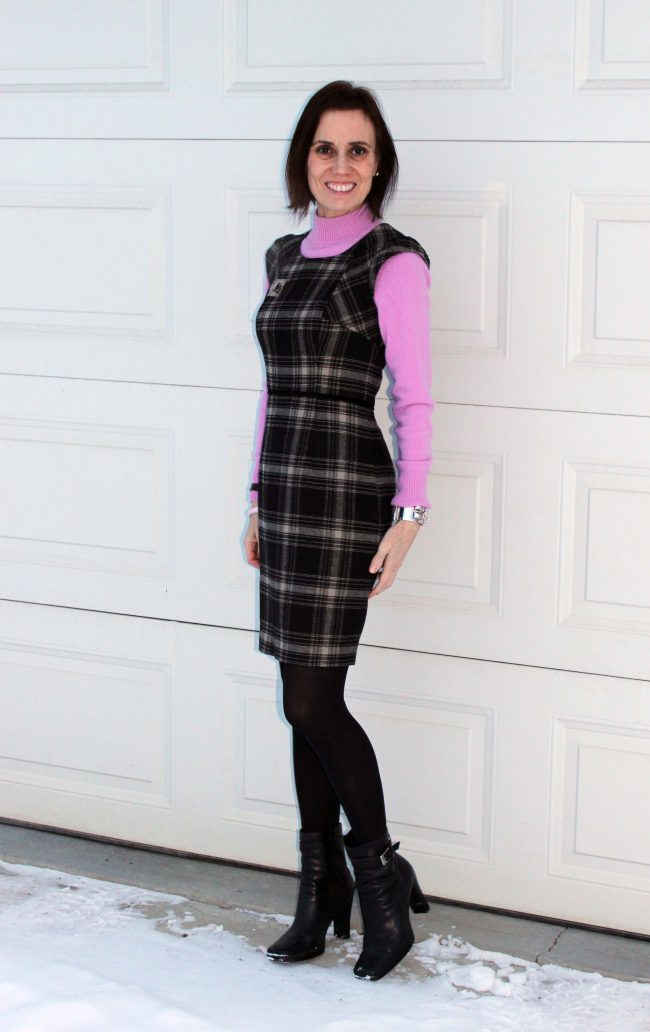 fashion blogger in plaid sheath with pink mockneck sweater