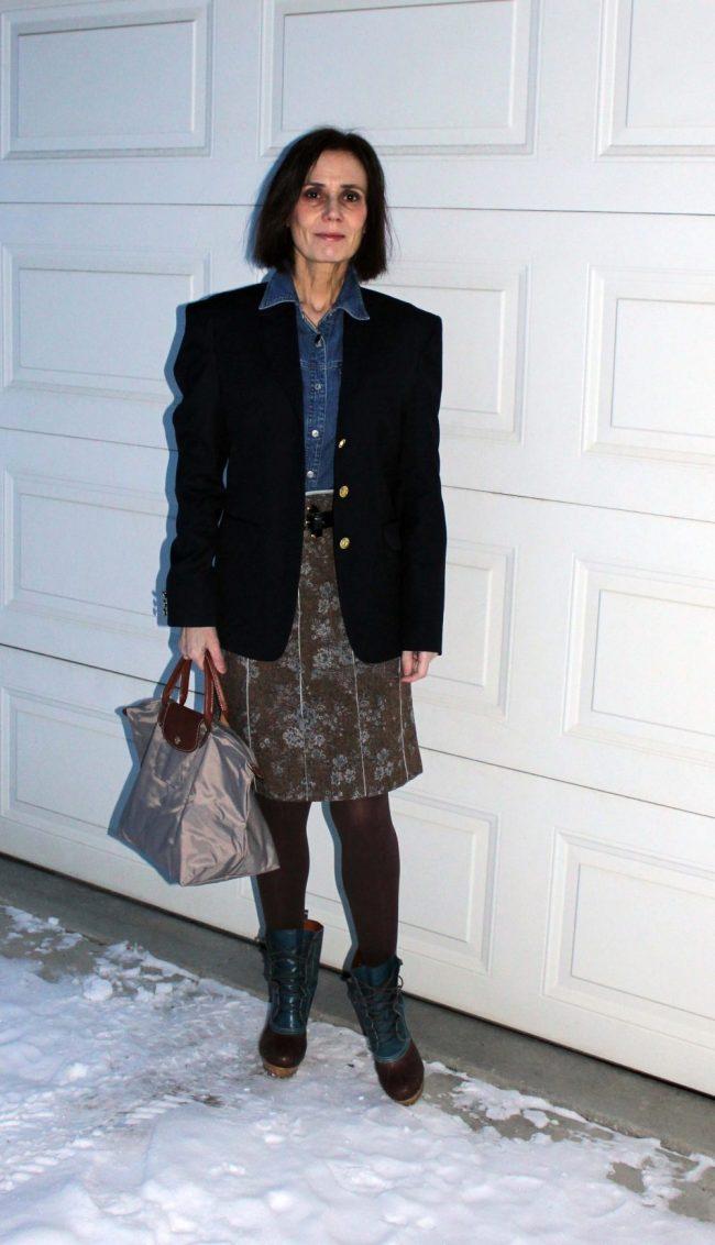 style influencer over 50 in otk-boots, tweet skirt, blazer, denim shirt