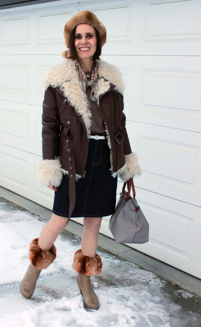 fashion blogger over 50 illustrating how to wear boot toppers