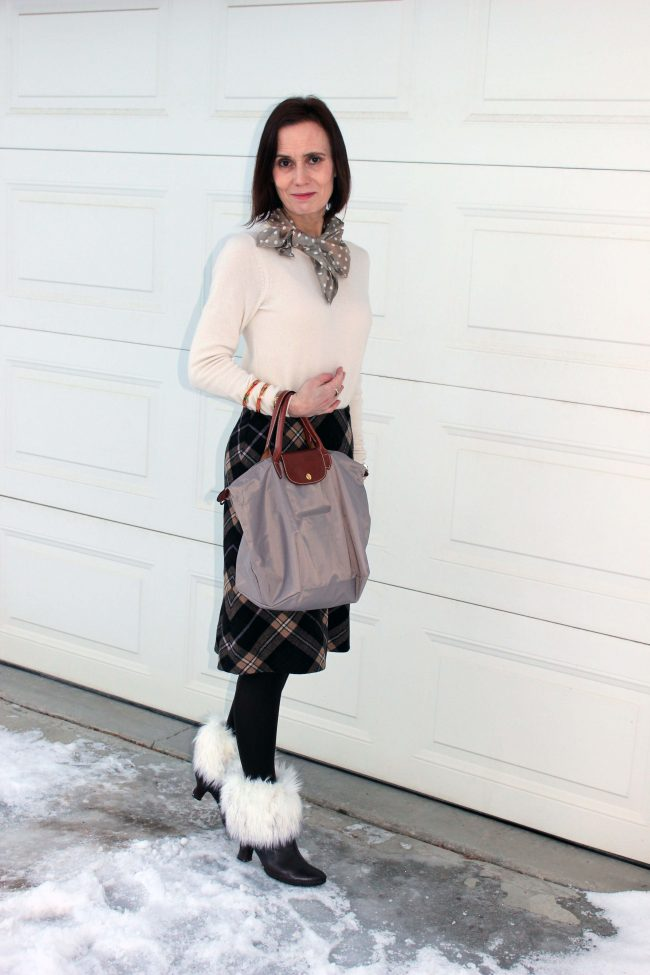 over 50 years old fashion blogger in A-line plaid skirt, sweater, scarf