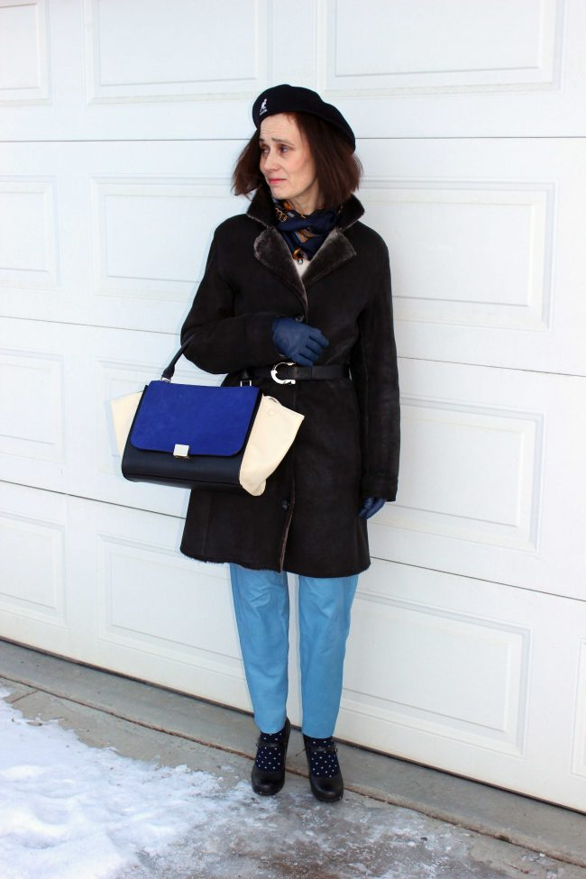 fashion blogger in blue leather pants, heels, outerwear