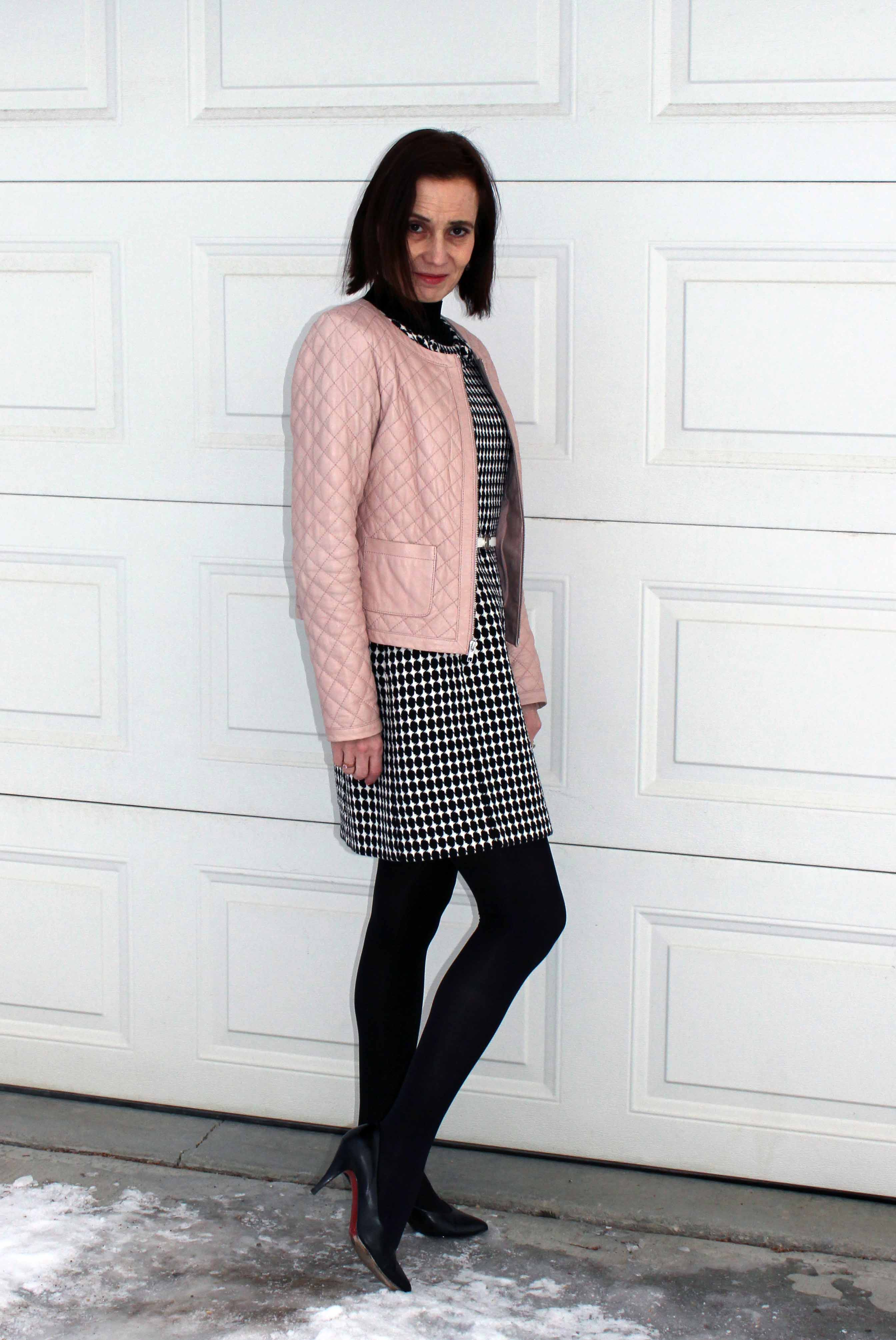 fashion blogger in desaturated outfit with blush jacket, houndstooth sheath dress