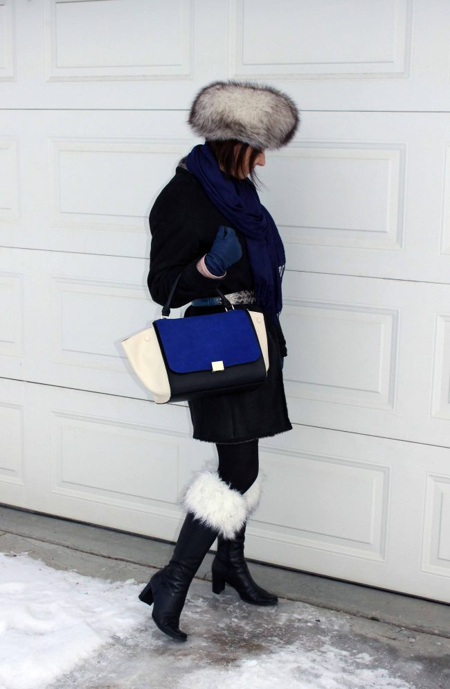 fashion blogger in tall boots with boot toppers