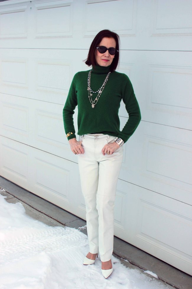 #fashionover50 woman wearing a green sweater