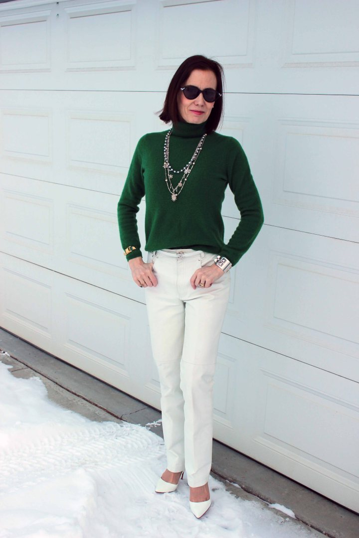Irish green sweater with white leather pants for the office on St. Patrick's Day