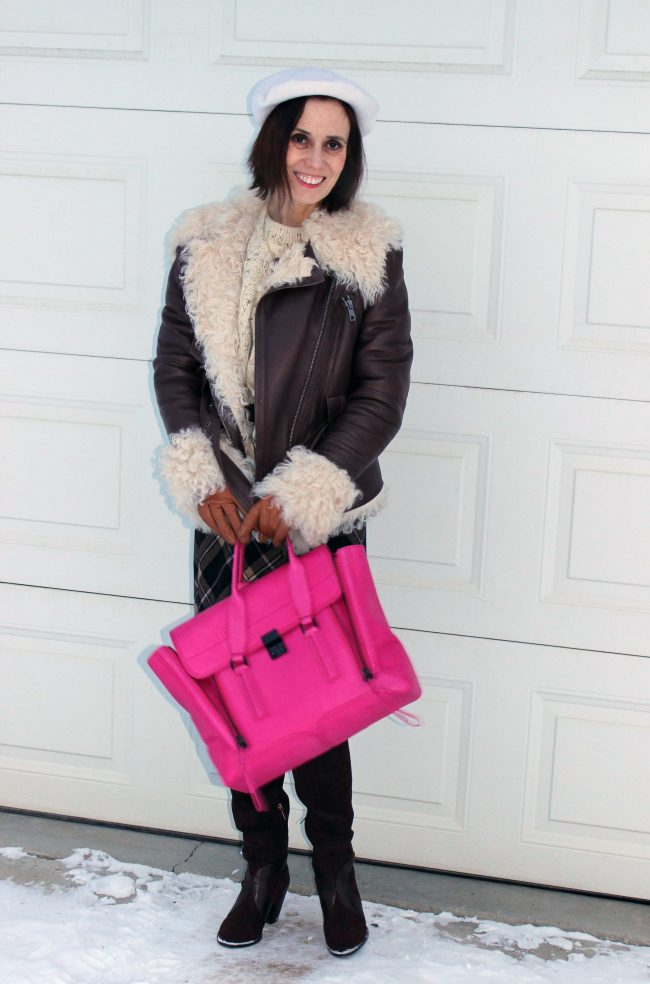 style blogger in brown motorcycle shearling jacket with fuchsia bag