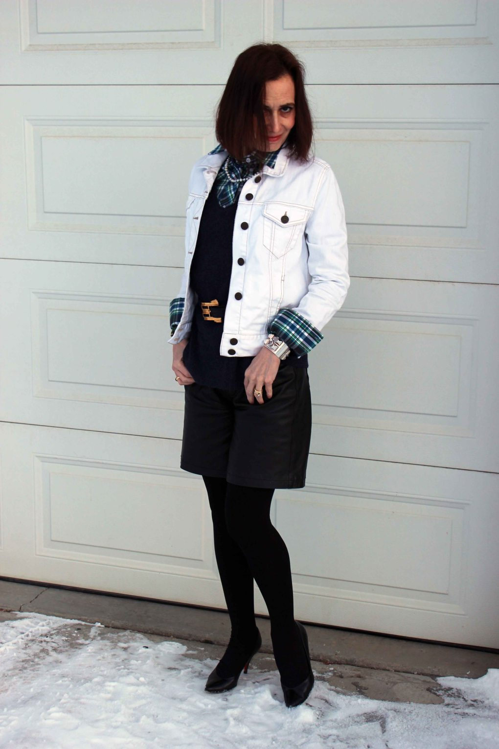 #fashionover50 woman in casual posh outfit with plaid shirt and leather shorts