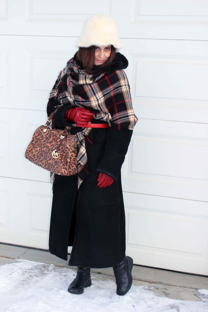 #fashionover50 woman in winter coat with blanket scarf and hat